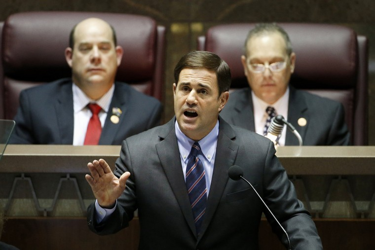 Arizona Republican Gov. Doug Ducey, front, gives his state-of-the-state address on Jan. 12, 2015, in Phoenix. (Photo by Ross D. Franklin/AP)