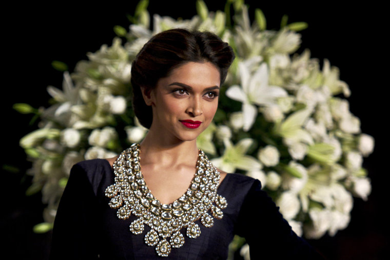 In this Sunday, Aug 4, 2013, photo Bollywood actor Deepika Padukone is seen at an event during the Delhi Couture Week in New Delhi, India. (Photo by Tsering Topgyal/AP)