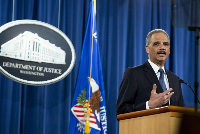 Attorney General Eric Holder speaks at the Justice Department in Washington, D.C., March 4, 2015. (Photo by Carolyn Kaster/AP)