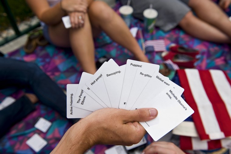 Students play Cards Against Humanity at an event in Denver, Colo. (Photo by Brian Cahn/Zuma)