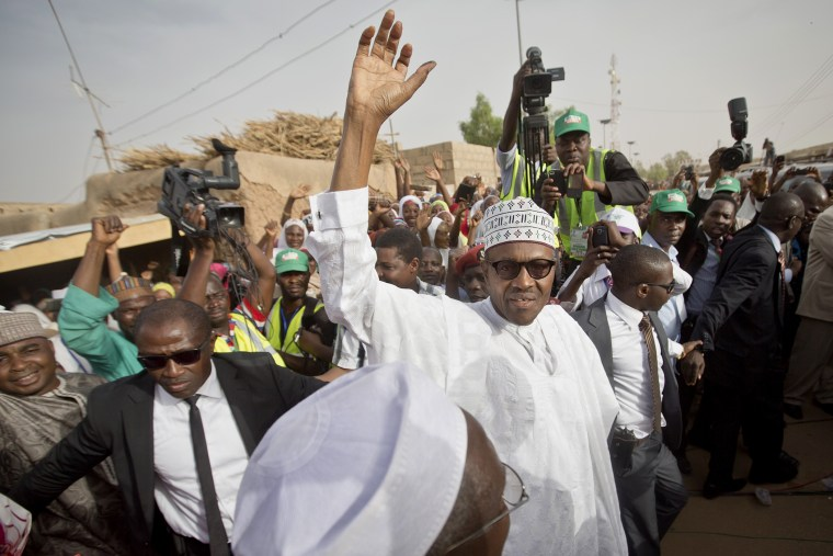 Gen. Muhammadu Buhari waves to supporters after casting his vote in his home town of Daura, northern Nigeria on March 28, 2015. (Photo by Ben Curtis/AP)