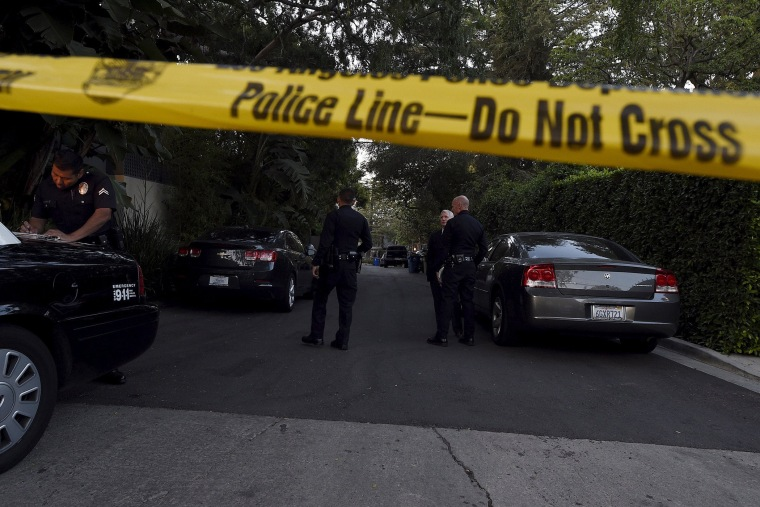 A yellow police tape and a police cruiser block off the street leading to the house of Andrew Getty, the grandson of Getty oil founder J. Paul Getty, in Los Angeles, Calif. on March 31, 2015. (Photo by Kevork Djansezian/Reuters)