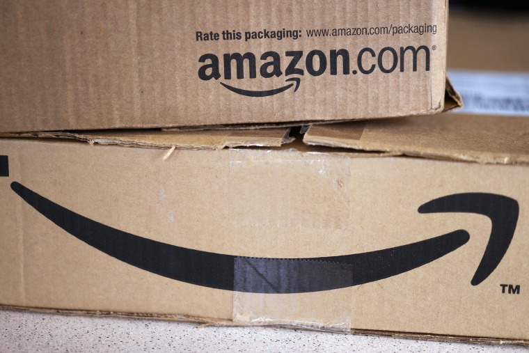 Two freshly delivered Amazon boxes are seen. (Photo by Rick Wilking/Reuters)