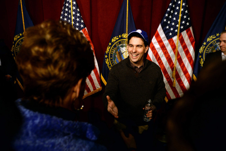 \Wisconsin Governor Scott Walker shakes hands with people following a grassroots training and rally event at Concord High School March 14, 2015 in Concord, N.H. (Photo by Darren McCollester/Getty)