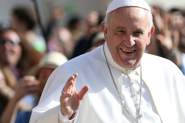 Pope Francis waves as he arrives in St. Peter's square for his general audience on April 1, 2015 in Vatican City, Vatican.