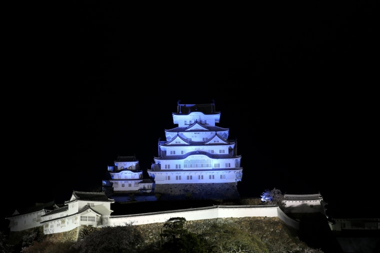 World Heritage Himeji Castle is illuminated in blue light to mark World Autism Awareness Day on April 2, 2015 in Himeji, Japan. (Buddhika Weerasinghe/Getty for Autism Speaks )