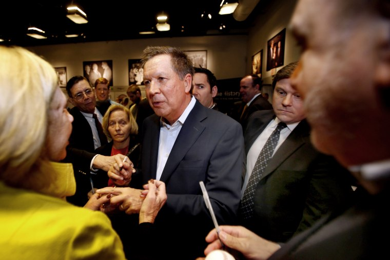 Ohio Gov. John Kasich, R-Ohio is greeted after speaking at a breakfast with state political activist and area business leaders hosted by the New Hampshire Institute of Politics at Saint Anselm College, March 24, 2015. (Photo by Jim Cole/AP)