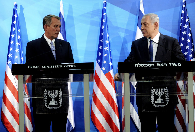 Israeli Prime Minister Benjamin Netanyahu looks at the Speaker of the US House of Representatives, John Boehner, as they deliver statements in Jerusalem April 1, 2015. (Photo by Debbie Hill/Reuters)