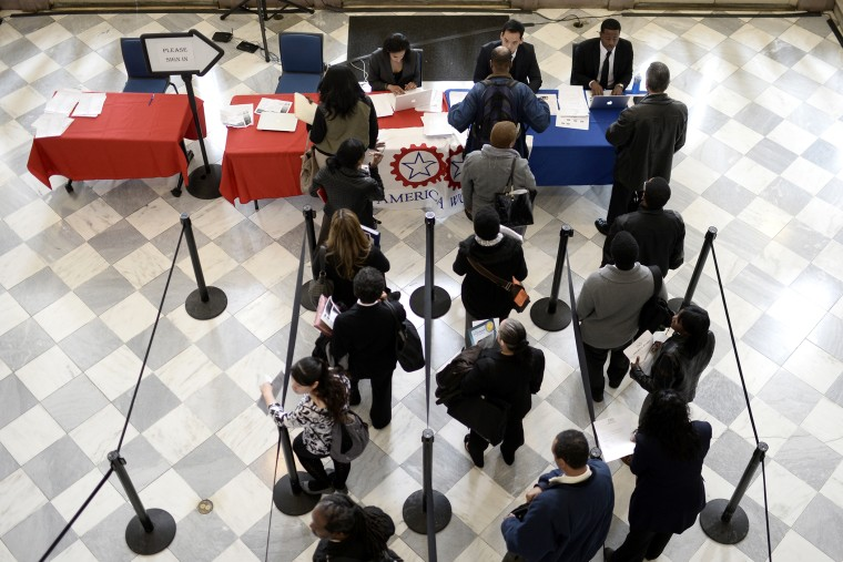 Job seekers wait to speak with employers at a job fair in the Brooklyn borough of New York, N.Y., on April 11, 2014. (Photo by Andrew Gombert/EPA)