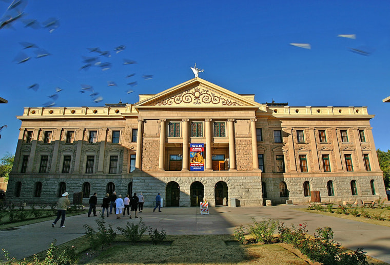 Citizens tour the Arizona Capitol grounds in Phoenix in this Dec. 14, 2004 file photo.
