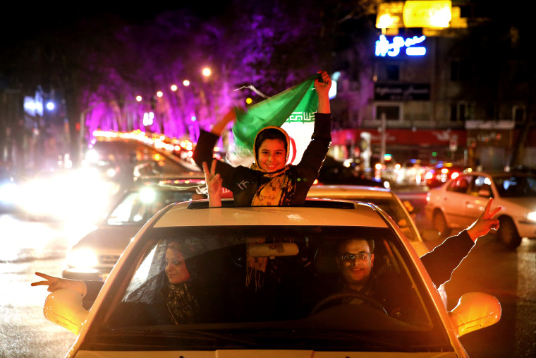 Iranians celebrate on a street in northern Tehran, Iran, April 2, 2015, after Iran's nuclear agreement with world powers in Lausanne, Switzerland. (Photo by Ebrahim Noroozi/AP)