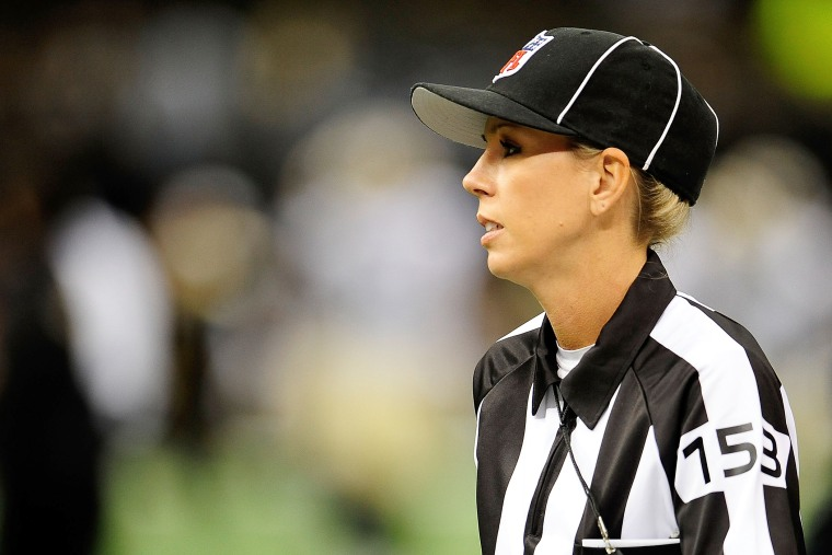 Line judge Sarah Thomas takes the field for a preseason game between the Oakland Raiders and the New Orleans Saints at the Mercedes-Benz Superdome on Aug. 16, 2013 in New Orleans, La. (Photo by Stacy Revere/Getty)