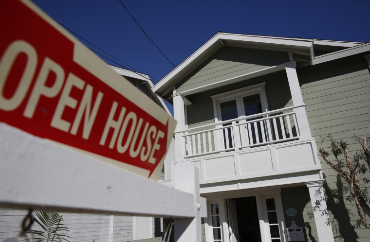 Open House signage is displayed outside of a home for sale in Redondo Beach, Calif., Feb. 14, 2015. (Photo by Patrick T. Fallon/Bloomberg via Getty)