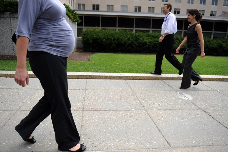 A pregnant woman walks outside the State Department on Aug. 5, 2010 in Washington, DC.