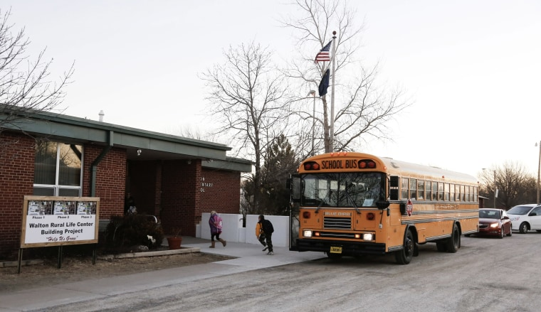 Students arrive at the Walton Rural Life Center Elementary School, in Walton, Kan., Jan. 18, 2013. (Photo by Jeff Tuttle/Reuters)