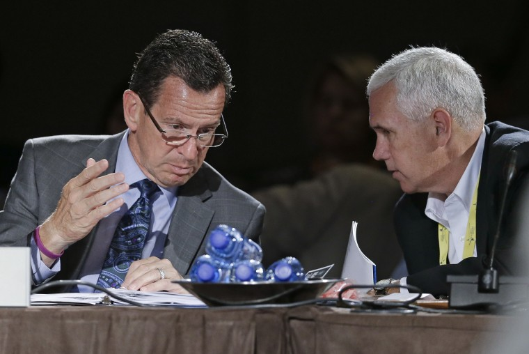 Connecticut Gov. Dan Malloy talks with Indiana Gov. Mike Pence during a meeting on jobs and education at the National Governors Association convention on July 12, 2014, in Nashville, Tenn. (Photo by Mark Humphrey/AP)