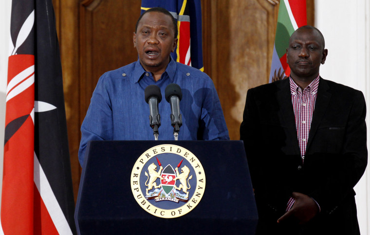 Kenyan President Uhuru Kenyatta (L), flanked by his Deputy William Ruto, addresses a news conference at the State House in the capital Nairobi April 4, 2015. (Photo by Thomas Mukoya/Reuters)