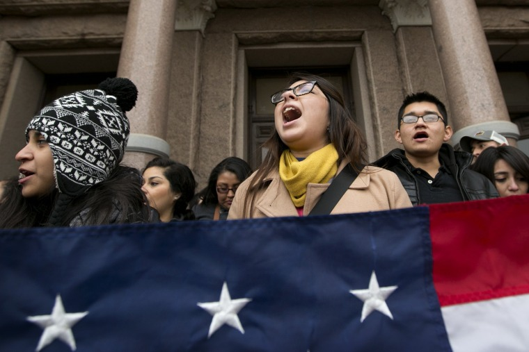 Maria Yolisma Garcia, 20, of Dallas rallies in support of the HB1403, the Texas DREAM Act, at a demonstration at the Capitol in Austin, Texas on Jan. 14, 2015. (Photo by Jay Janner/Austin American-Statesman/AP)