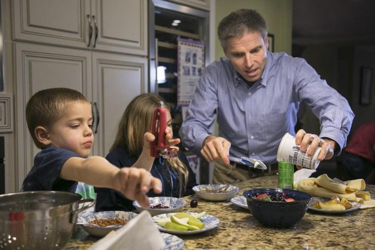Carl Krawitt makes dinner for his son Rhett, 6, left, and daughter Annesley, 8, center, in their home in Corte Madera, Calif. on Jan. 28, 2015.