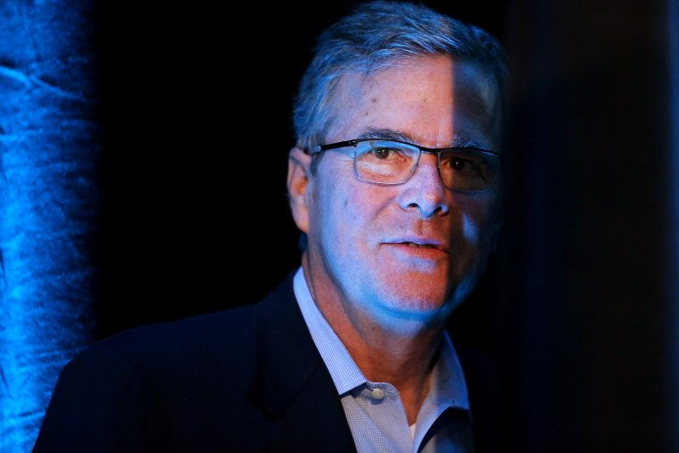 Former Florida Governor Jeb Bush waits to be introduced at the Iowa Ag Summit on March 7, 2015 in Des Moines, Iowa. (Photo by Scott Olson/Getty)