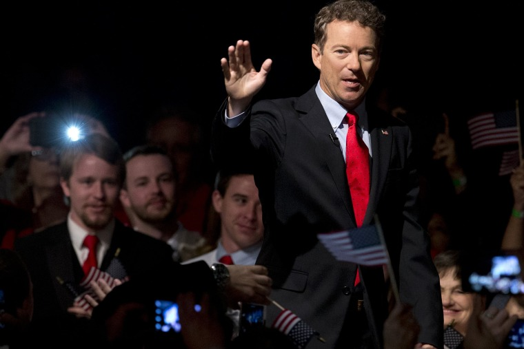 Sen. Rand Paul, R-Ky. arrive to a cheering and photo taking crowd for his announcement of the start of his presidential campaign, Tuesday, April 7, 2015, at the Galt House Hotel in Louisville, Ky. (Photo by Carolyn Kaster/AP)