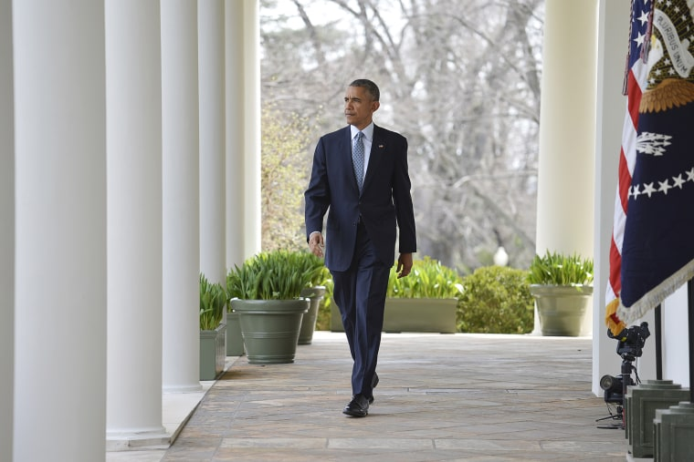 U.S. President Barack Obama walks out of the Oval Office and down the White House colonnade to make a statement in the Rose Garden in Washington, D.C., April 2, 2015. (Photo by Mike Theiler/Reuters)