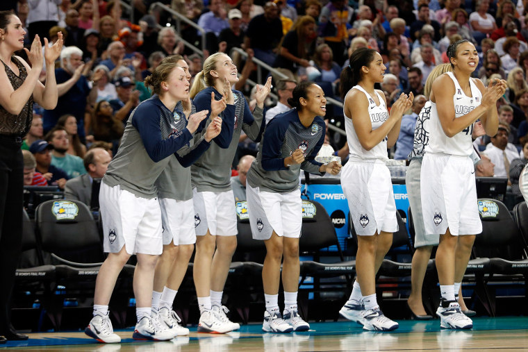 The Connecticut Huskies bench reacts against the Notre Dame Fighting Irish during the NCAA Women's Final Four National Championship at Amalie Arena on April 7, 2015 in Tampa, Fla. (Photo by Brian Blanco/Getty)