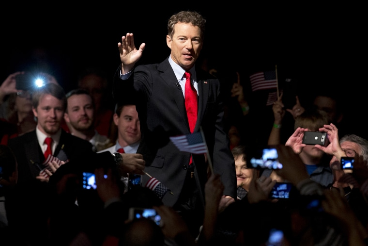 Sen. Rand Paul, R-Ky. arrive to a cheering and photo taking crowd for his announcement of the start of his presidential campaign, April 7, 2015, at the Galt House Hotel in Louisville, Ky. (Photo by Carolyn Kaster/AP)