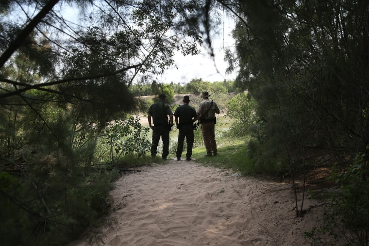 Law enforcement agents watch for immigrants crossing the Rio Grande illegally into the United States on July 24, 2014 in Mission, Texas. (Photo by John Moore/Getty)