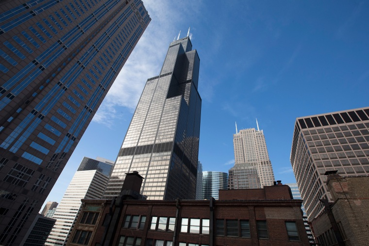 The Willis Tower (C), formerly known as the Sears Tower, dominates the southern end of the downtown skyline in Chicago, Illinois. (Photo by Scott Olson/Getty)