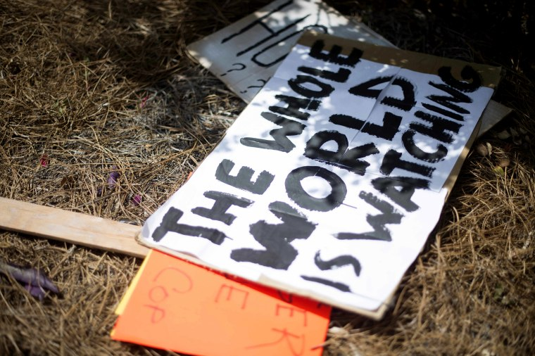 Placards litters the ground after protesters gathered outside the North Charleston City Hall in North Charleston, SC on April 8, 2015. (Photo by Jim Watson/AFP/Getty)