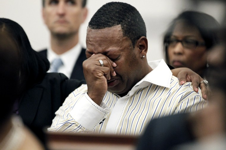 A family member cries as Barbara Anderson Young, sister of James Craig Anderson, reads a statement in Hinds County Circuit Court, March 21, 2012 in Jackson, Miss. (Photo by Rogelio V. Solis/AP)