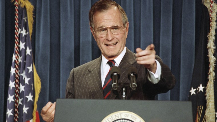 President George H.W. Bush acknowledges a reporter during a news conference at the White House on Dec. 5, 1991. (Photo by Greg Gibson/AP)