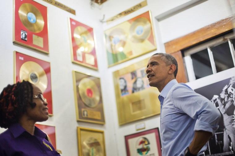 U.S. President Barack Obama, right, visits the Bob Marley Museum with tour guide Natasha Clark, left, April 8, 2015 in Kingston, Jamaica.