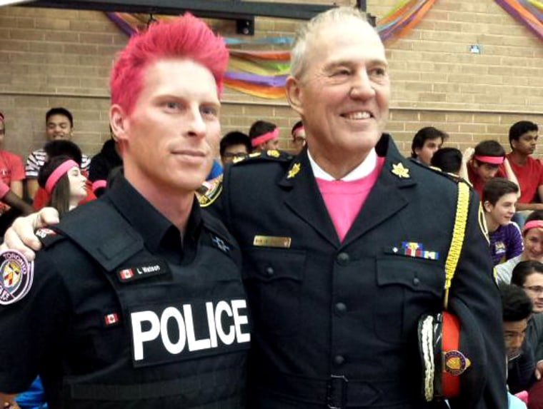 Toronto Police Constable Luke Watson, who dyed his hair pink to raise awareness around LGBT bullying, and his chief at a Day of Pink event at the Forest Hill Collegiate Institute, April 8, 2015. (Photo courtesy of Luke Watson via Twitter)
