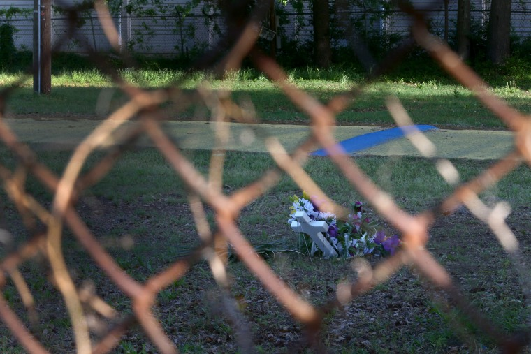 A memorial is seen through a fence marking the site where Walter Scott was killed on April 4th by a North Charleston police officer on April 10, 2015 in North Charleston, S.C.