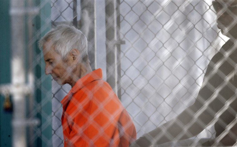 Robert Durst is escorted into Orleans Parish Prison after his arraignment in Orleans Parish Criminal District Court in New Orleans, March 17, 2015. (Photo by Gerald Herbert/AP)
