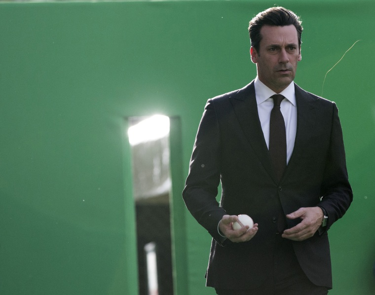 """Cast member Jon Hamm holds a baseball as he attends the premiere of """"Million Dollar Arm"""" at El Capitan theatre in Hollywood, Calif. May 6, 2014. (Photo by Mario Anzuoni/Reuters)"""