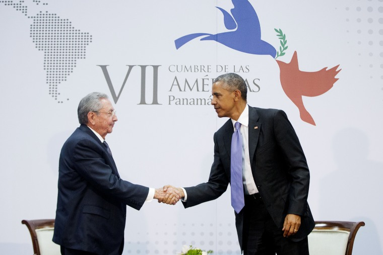 US President Barack Obama and Cuban President Raul Castro shake hands at the Summit of the Americas in Panama City, Panama, Saturday, April 11, 2015. (Photo by Pablo Martinez Monsivais/AP)
