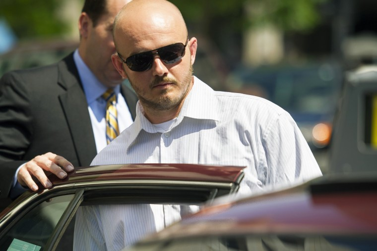 In this June 11, 2014, file photo, former Blackwater Worldwide guard Nicholas Slatten enters a taxi cab as he leaves federal court in Washington, D.C., after the start of his trial. (Photo by Cliff Owen/AP)