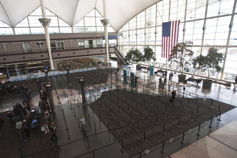 Passengers wait in security lines at the Denver International Airport in Denver, Colo. (Photo by Nathan Armes/Reuters)