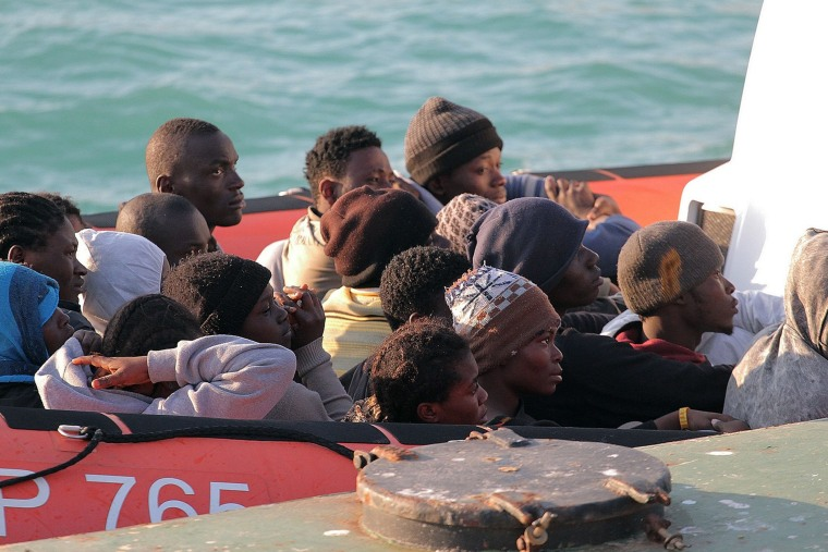 Migrants on a Coast Guard dinghy boat arrive at the Sicilian Porto Empedocle harbor, Italy, Monday, April 13, 2015. Italy's Coast Guard helped save 144 migrants Monday from a capsized boat in the waters off Libya. (Photo by Calogero Montanalampo/AP)