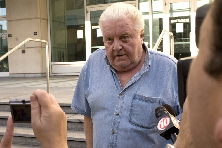 Former Chicago Police Department commander Jon Burge walks by reporters outside the Federal Courthouse after he was released from custody Tuesday afternoon, Oct. 21, 2008 in Tampa, Fla. (Photo by Steve Nesius/AP)