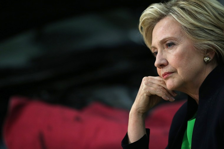Democratic presidential hopeful and former Secretary of State Hillary Clinton looks on during a roundtable discussion with students and educators on April 14, 2015 in Monticello, Iowa. (Photo by Justin Sullivan/Getty)