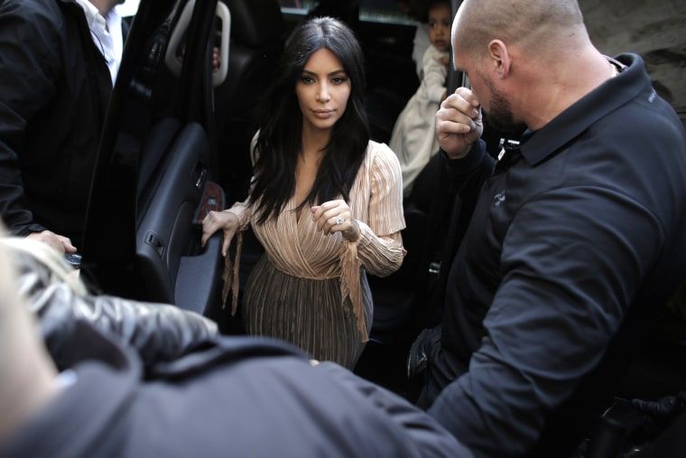 US reality TV star Kim Kardashian exits a car upon her arrival with husband rapper Kanye West and daughter North, at the Armenian St. James Cathedral in Jerusalem's Old City on April 13, 2015. (Photo by Ahmad Gharabli/AFP/Getty)