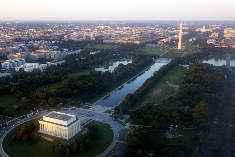The skyline of Washington, D.C., including the Lincoln Memorial, Washington Monument, US Capitol and National Mall, is seen from the air at sunset in this photograph taken on June 15, 2014. (Photo by Saul Loeb/AFP/Getty)