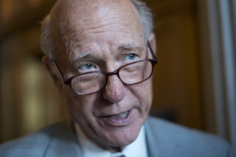 Sen. Pat Roberts, R-Kan., talks with reporters before a Senate luncheon at the Capitol in 2012.