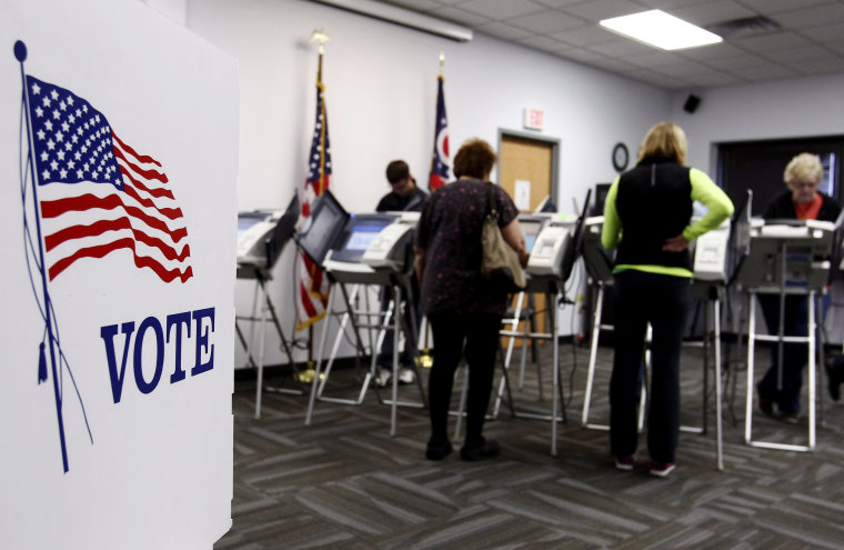 Ohio voters cast their votes at the polls for early voting in the 2012 US presidential election in Medina, Ohio, Oct. 26, 2012. (Photo by Aaron Josefczyk/Reuters)
