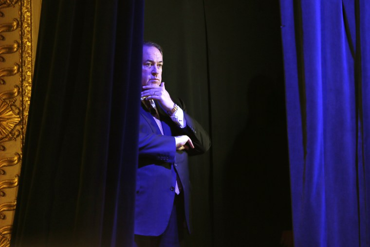 Former Arkansas Gov. Mike Huckabee waits backstage before speaking during the Freedom Summit, Jan. 24, 2015, in Des Moines, Iowa. (Photo by Charlie Neibergall/AP)