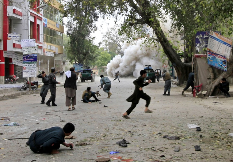 People run for cover after an explosion in Jalalabad April 18, 2015. A suicide bomb blast in Afghanistan's eastern city killed 33 people and injured more than 100 outside a bank where government workers collect salaries. (Photo by Parwiz/Reuters)